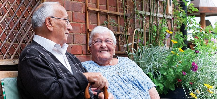 picture of older man and woman smiling together